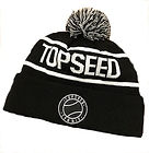 The front of a black and white Topseed Tennis branded beanie with a pompom on top.