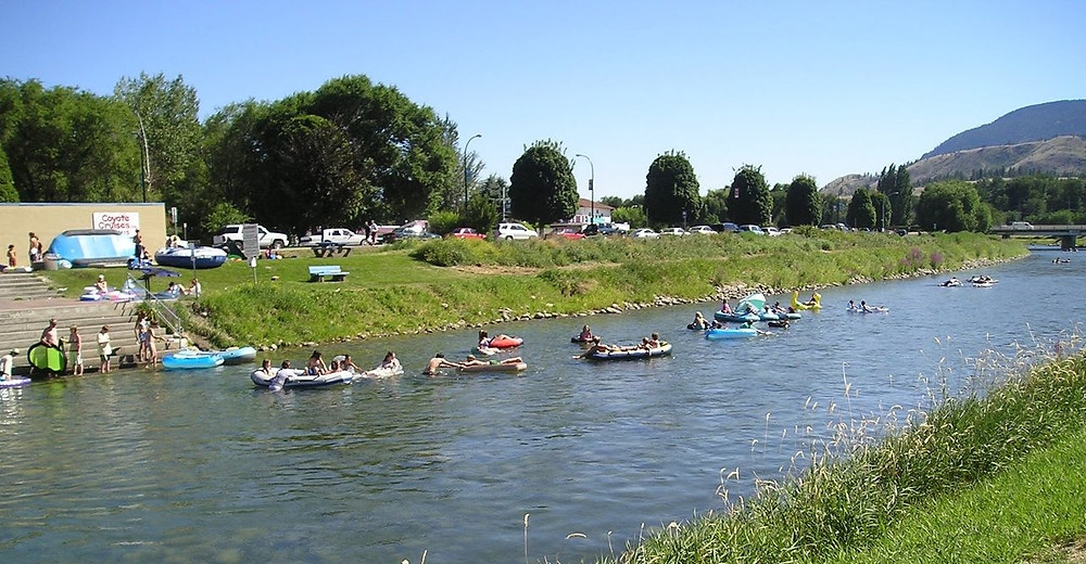 People floating on the Penticton channel