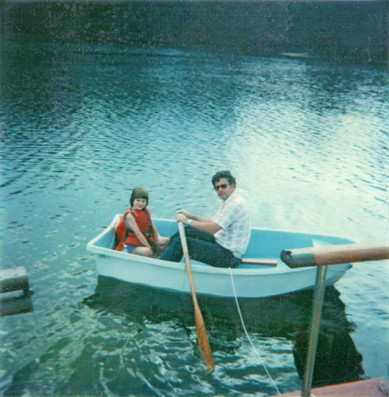 1980 or so, dad and robin rowing around