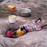 kpalga woman scooping water.jpg