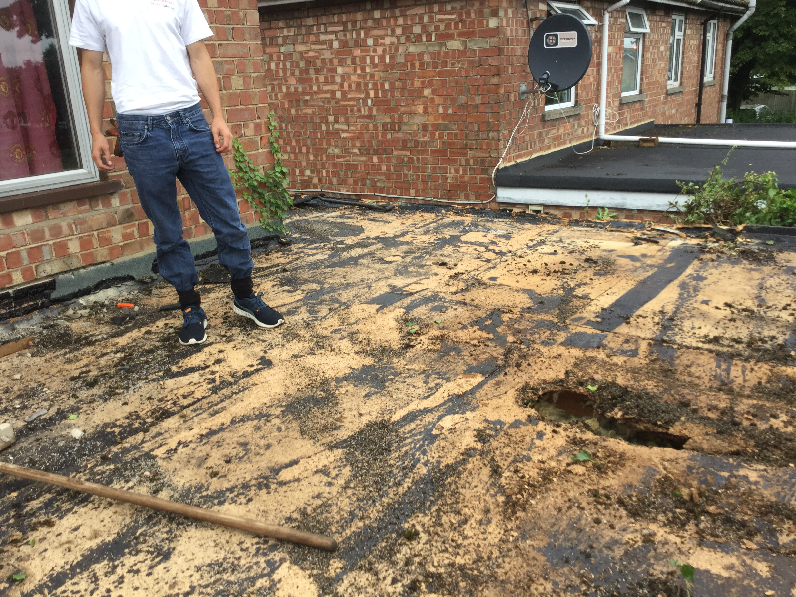 2. Stripping old roof covering