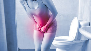 woman with urine urgency in the toilet.j