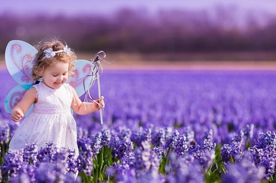 bigstock-Little-Girl-Playing-In-Hyacint-