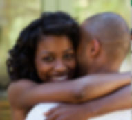 blk couple hugging cropped.jpg