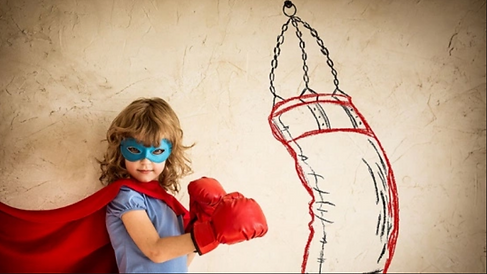 girl with mask and drawn punching bag.pn