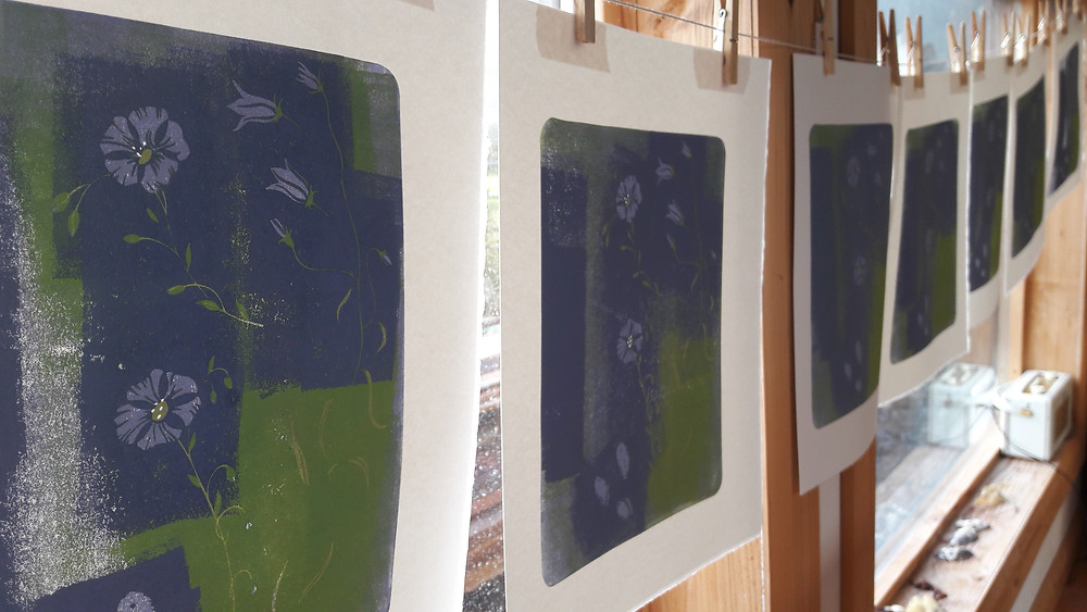 Prints drying in the studio, waiting for the background colour to be printed.