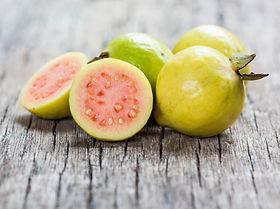 Fresh guava fruit on wooden table..jpg