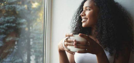 black-woman-drinking-tea-window-520x245.