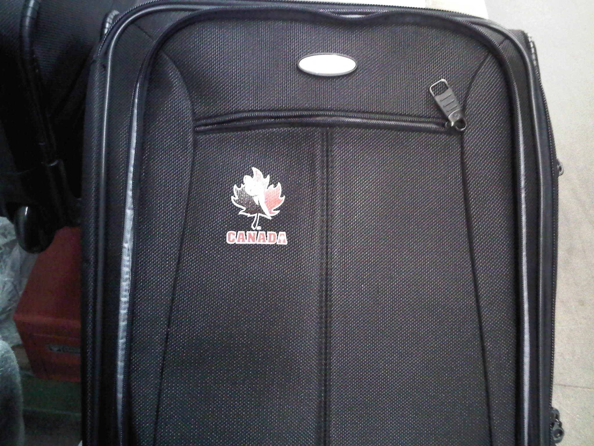2010 rugby samsonite small luggage.jpg