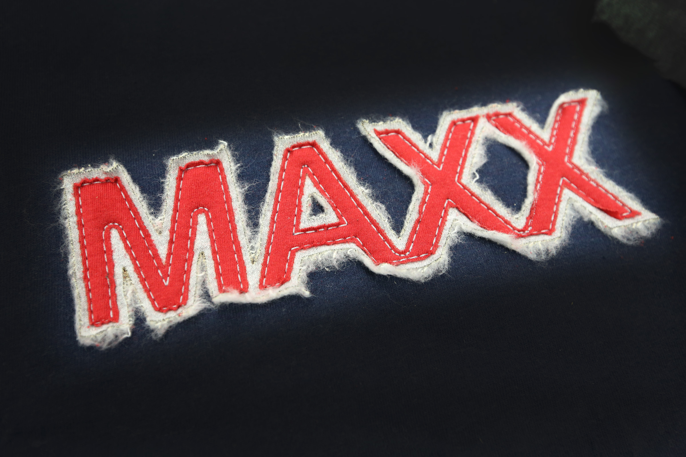 Maxx tackle twill logo.jpg