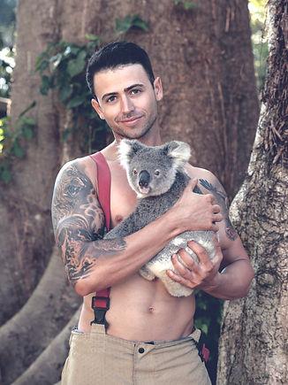 Man holding koala