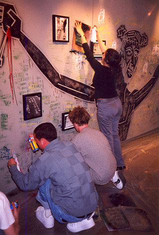 """Participants installing """"Talking Walls and Sidewalks"""" at Virginia Tech's Armory Gallery, 2000"""