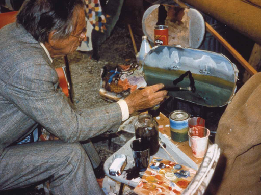 Finster painting a chair at the Horton Studio, 1985