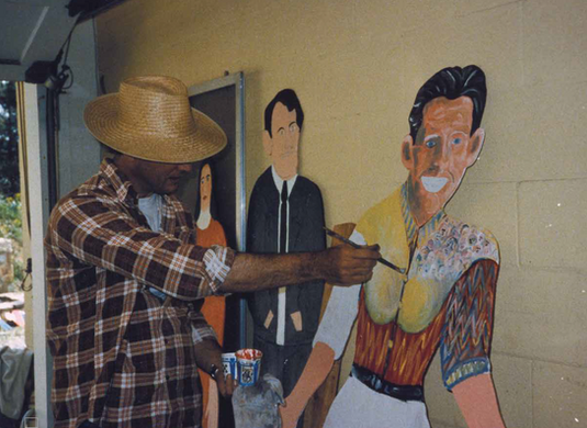 Ray Kass painting Howard Finster in his Li'l Dress