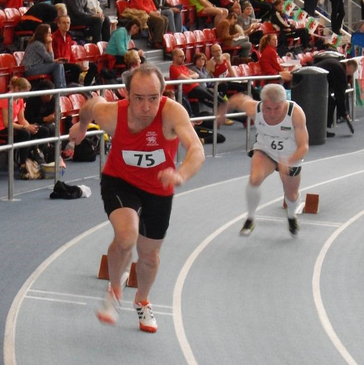 Robin Wood sets off in a very competitive M50 200m race