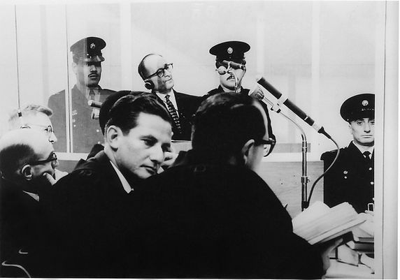 Adolf Eichmann listens to the proceeding