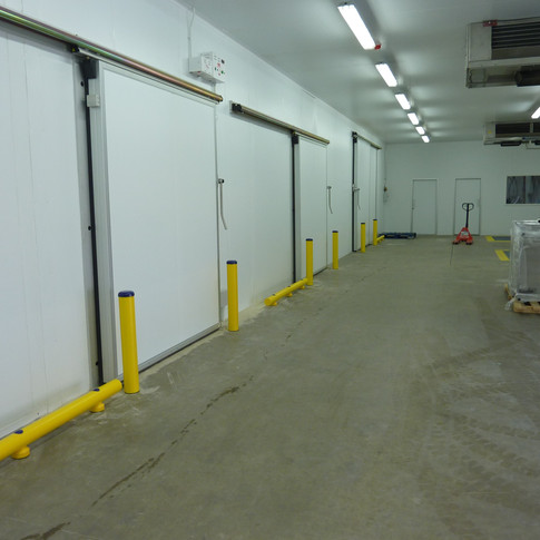 Bollards and Low Guiderails Protecting Sliding Doors and Panelling