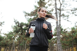 graphicstock-image-of-young-lady-runner-in-warm-clothes-and-headphones-looking-aside-in-autumn-park-