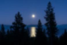 Moon bursting over a gorgeous alpine lake