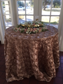 Gold table cloth in sunroom