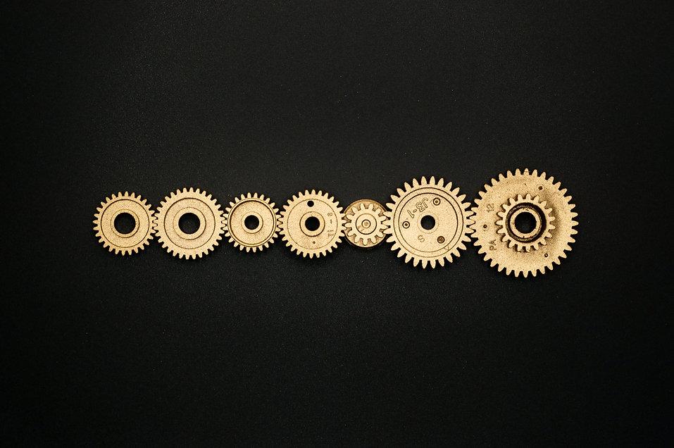 photo-of-golden-cogwheel-on-black-backgr