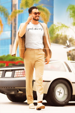 t-shirt-mockup-featuring-a-stylish-man-with-sunglasses-walking-by-a-retro-car-m12017