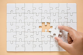 hand-connecting-puzzle-pieces-table-back
