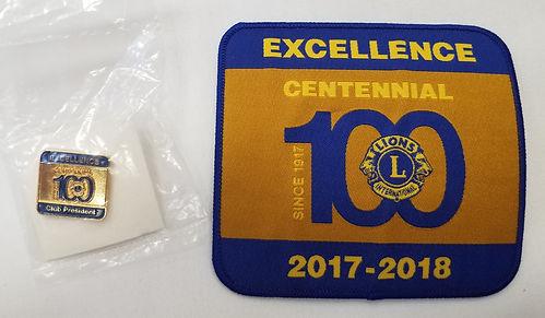 Centennial Badge and Pin.jpg
