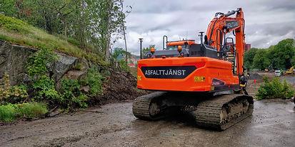 Asfalttjänst grävmaskin i Kallebäck