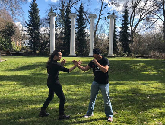 Sifu Matt Emery and Sifu Snake Blocker training at the site of Bruce Lee's first training area on Washington University campus; also the site where Bruce Lee asked Linda Emery on their first date (later to marry her).
