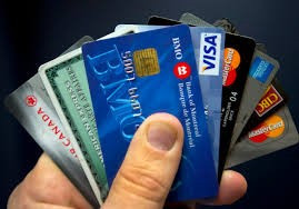 hand full of credit cards