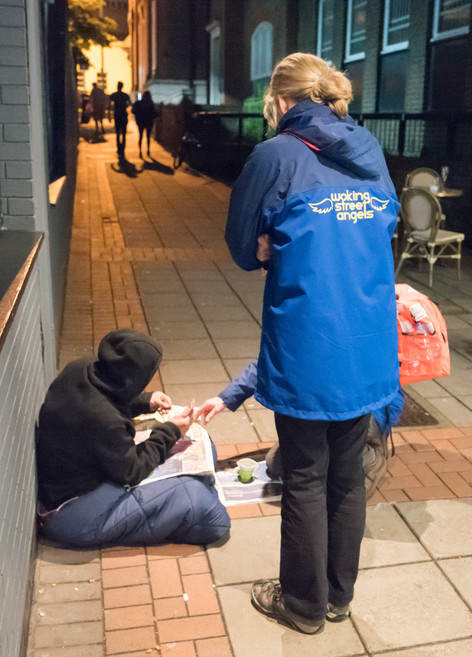 Street Angels assisting a rough sleeper in Church Path