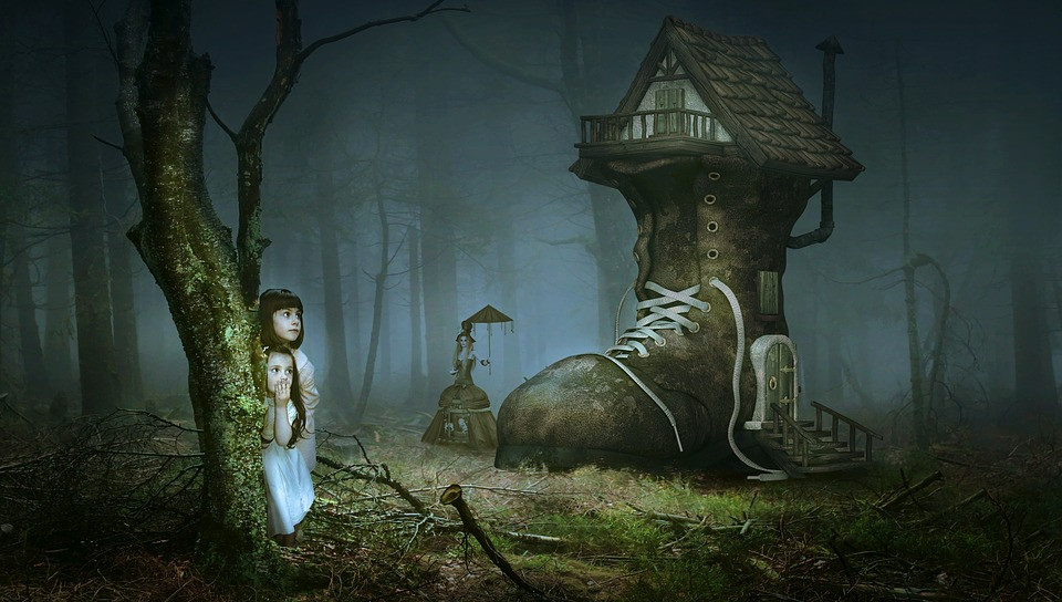 two frightened girls hiding behind a tree in a spooky forest looking at a home made out of a large boot which could be home to the Hahndorf witches