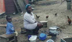 Ghana woman cooking