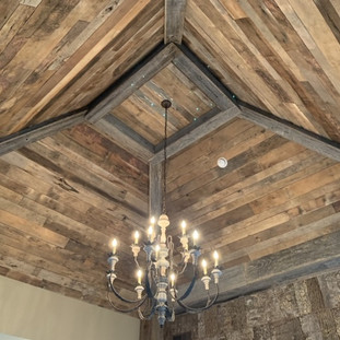 Bedroom Vaulted Ceiling | Brown Hardwood Paneling