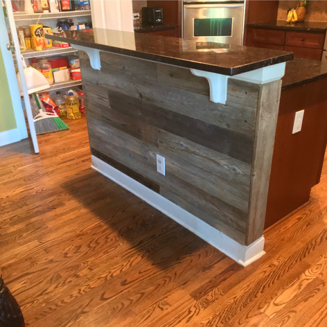 Kitchen Island Wrapped in Reclaimed Wood Paneling