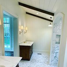 Reclaimed beams on bathroom ceiling