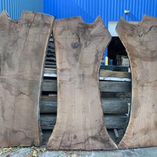 A trio of walnut live edge slabs