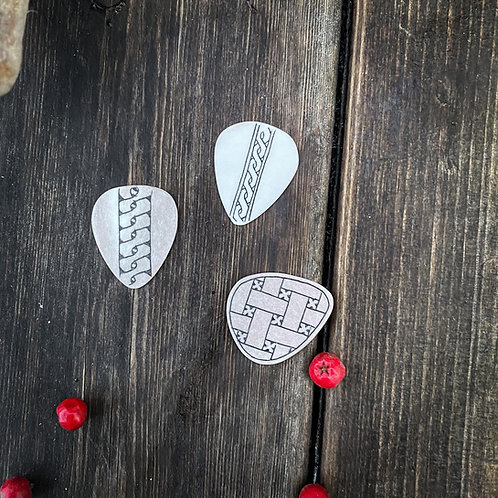 Plectrum (pick) with engraving