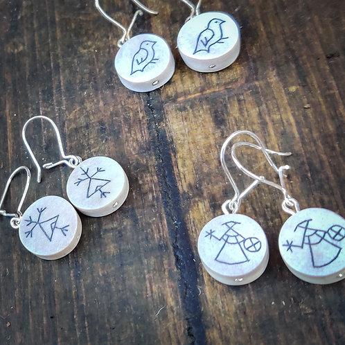 Korvakorut saamelaisella symbolilla