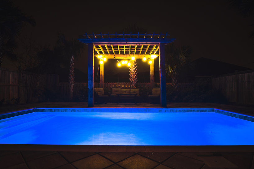 Tideline Pools Relaxing Patio with Pool at night