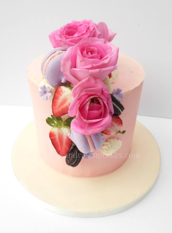 Elegant floral birthday cake, raspberry and lemon