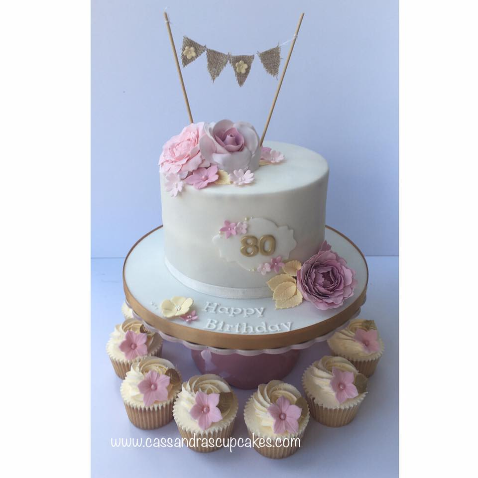 Pretty 80th themed birthday cake and cupcakes