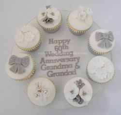 Pretty 60th wedding anniversary cupcakes with edible silver leaf