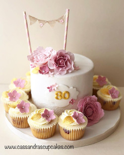 Pretty 80th birthday cake and cupcakes