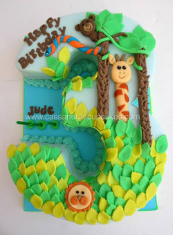 Number 3 shaped jungle themed cake