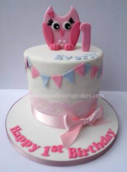 Pretty girls 1st birthday cake with rainbow sponge inside!