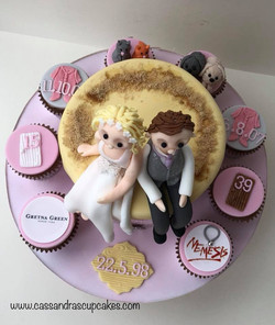 Themed anniversary cake with bride and groom figures