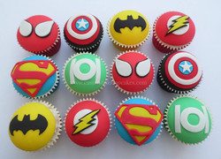 Superhero themed cupcakes, image was supplied for the design.