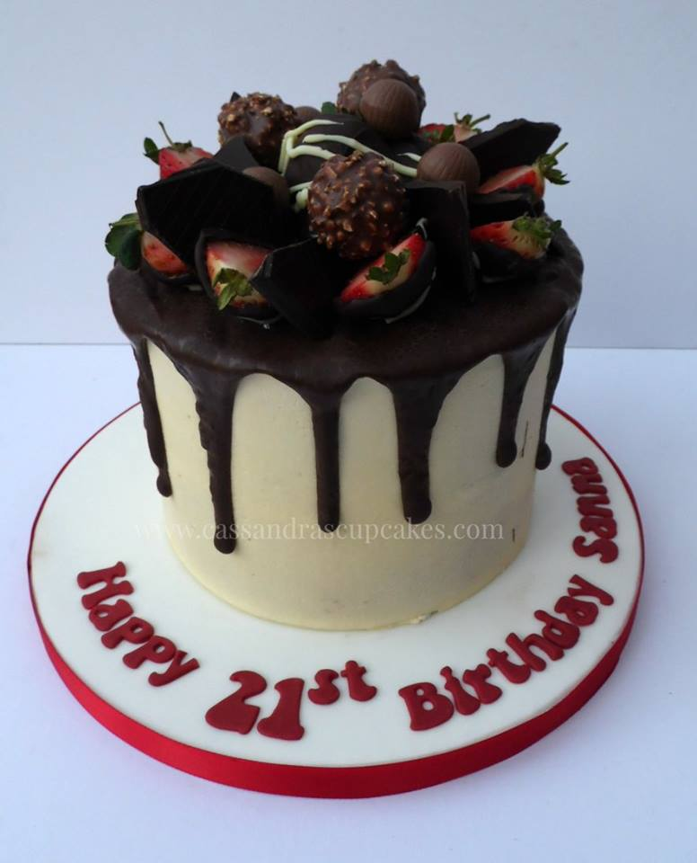 Chocolate drip cake with chocolate covered strawberries, lindt chocolates and ferrero rocher
